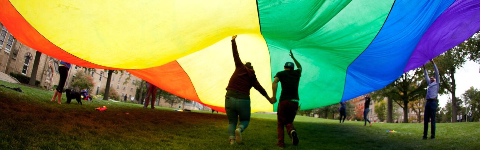 Friends under a rainbow flag