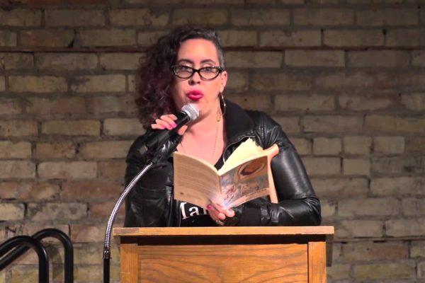 Leah Lakshmi Piepzna-Samarasinha at a podium